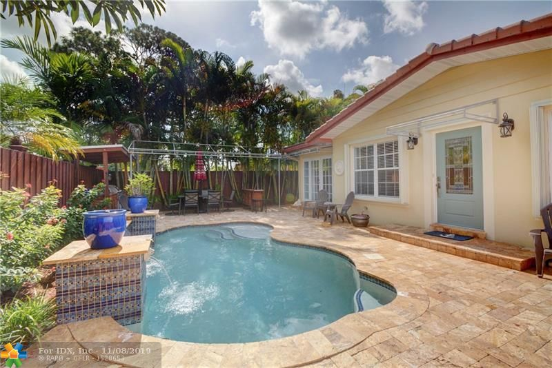 Prime location in Wilton Manors.Pride of ownership shows in this meticulously cared for home. Resort style pool lined with lush landscape and travertine pavers create a tropical oasis. Owner installed color changing landscape lightning that makes it perfect for nighttime entertaining.Pool is heated for year round use! Custom wooden front gate offers complete privacy and security. Huge driveway with plenty of space for all your guests or for storing your boat or RV. The home features African Acacia engineered wood floors, tankless water heater, custom kitchen cabinetry, Electrolux range and exterior vented hood. Brand new Trane XR16 3 Ton 16 Seer Air Conditioning System installed August 2019 which includes a 5 year transferable warranty. Minutes to all major highways, airport & beaches.