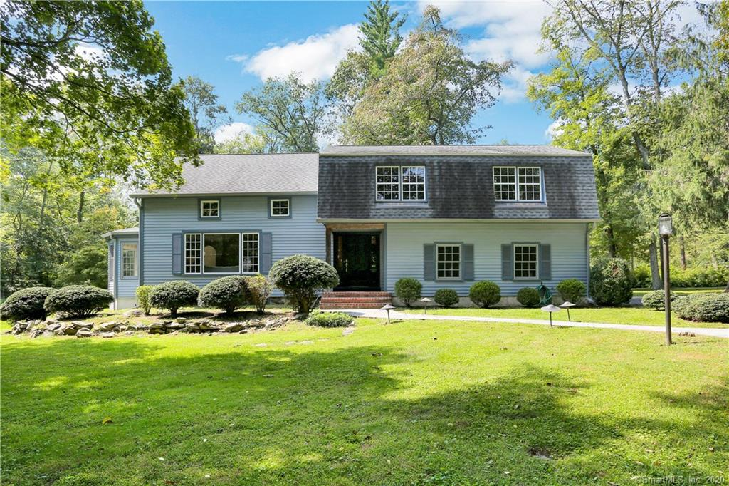 Wonderful space & amazing yard make this lovely Colonial a must see!  Freshly painted interiors, brand new Hardwood Floor in Dining Room, new Eat-In Kitchen, Powder Room and Foyer tiled floor and new 2nd floor carpeting are just some of the features that make this home move-in ready.  Spacious Living Room; formal Dining Room with Bayed Window Wall, 2 story ceiling and separate Wet-Bar in open the Butler's Pantry with wine cooler & mini refrigerator opening fabulous Family Room with pegged Hardwood Floors, stone Fireplace wall, Skylight, and 2 triple Sliders to wrap around Deck. Large Screened Porch with brick floor accessible from both Family Room and Eat-In Kitchen, Powder Room and direct garage access complete the Main Level. Upstairs you'll find a private Master Bedroom with Skylights, Vaulted Ceiling, incredible walk-in closets and luxurious Master Bath with radiant heated Marble Floor, wonderful Steam Shower with dual heads and controls, heated towel rack plus Skylight and Vaulted Ceiling. Three additional generous Bedrooms, Full Hall Bath and Laundry Room on the 2nd Level.  Lower Level has tiled Playroom and generous Wine Cellar with separate temperature control with spacious area outside-perfect for a tasting table and good storage. Beautiful level & lighted yard with tons of space for all your outdoor enjoyment! City water is a plus!