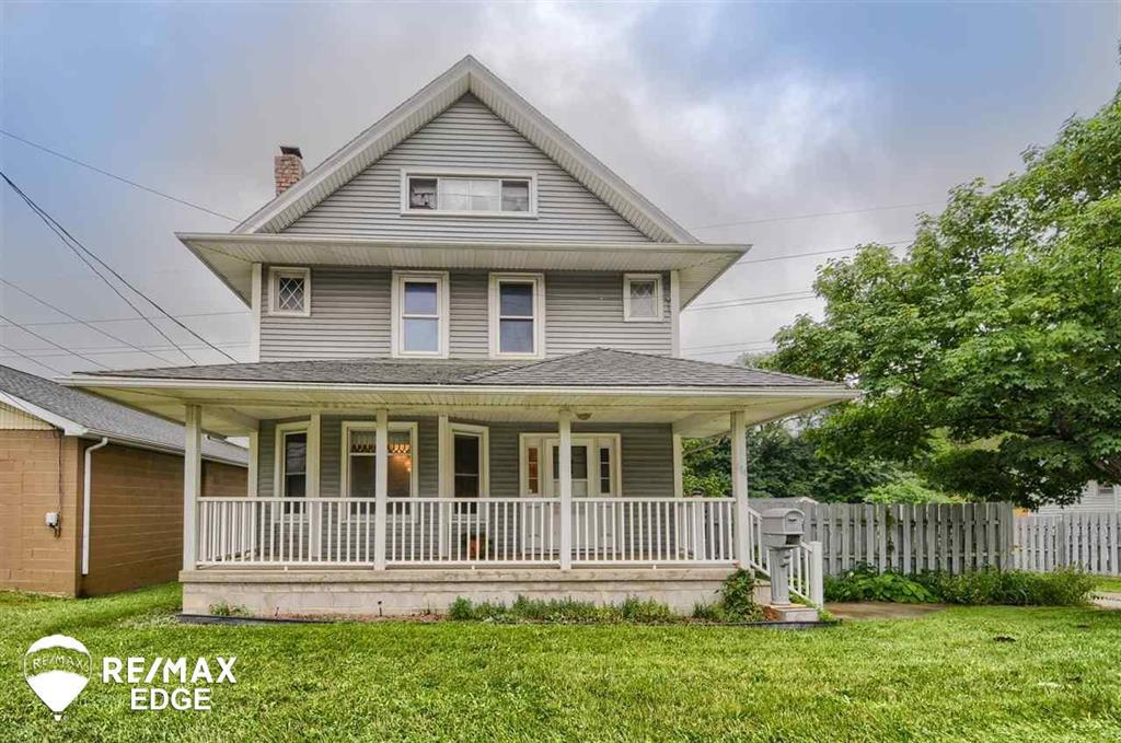 This beautiful 5 bedroom estate built in 1905 boasts lot's of original character. Hardwood floors throughout, leaded glass windows, wood burning fireplace, and intricate ceiling molds.  Conveniently located close to Downtown Owosso the home sits on a large lot and features a covered front porch, a third story bedroom/bonus room, a 3-car garage with a work shop, and a huge covered back deck perfect for entertaining.  Roof, siding, windows, electrical, front porch, driveway, and garage all re done in the last 15 years.  All appliances included.  ***Estate sale happening July 17th, 2021***
