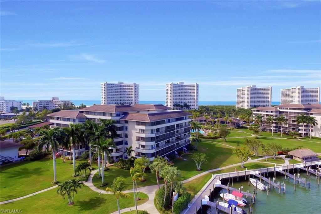 Introducing one of the BEST VIEWS you'll find at the South Seas Club Mid-Rises of Marco: Wide & Long Clam Bay, Gulf, Dock, Pool, Garden, Chickee Hut, Tower & Splendid Sunsets VISTAS!  You will be mesmerized in this Sixth Floor 2Bd/2Ba Condo with W/Sunset Exposure & Extra Storage Closet on its Lanai accessed by Living Rm & Master!  Turnkey Furnished with Wood Murphy Bed/Office Installation, Renovated Baths with Elevated Ceilings & High Corian Vanities, Master Suite w Lanai Access & Walk-In Shower, Fully Equipped Kitchen, Own In-Unit Laundry Rm + Coveted Carport w Extra Storage.  You can not beat the Unparalleled Amenities: Manned Gate 24x7, Boat Slips, Tennis, Bocce & Pickle Ball, Shuffleboard, Kayak Storage, Chickee Huts, BBQ Grills, Fishing Dock + Private Access to Beach! The Affordability, Views, Lifestyle & Condition of this Mid-Rise Residence Are unbeatable.  Make it your first investment & generate substantial rental income Until you have time to enjoy it with Family & Friends. This unit has been very well maintained and is ready to rent Or take occupancy.  Start living the Florida Dream at the Fabulous South Seas Club of Marco! Walk to Dining & Shopping Owner Agent interest