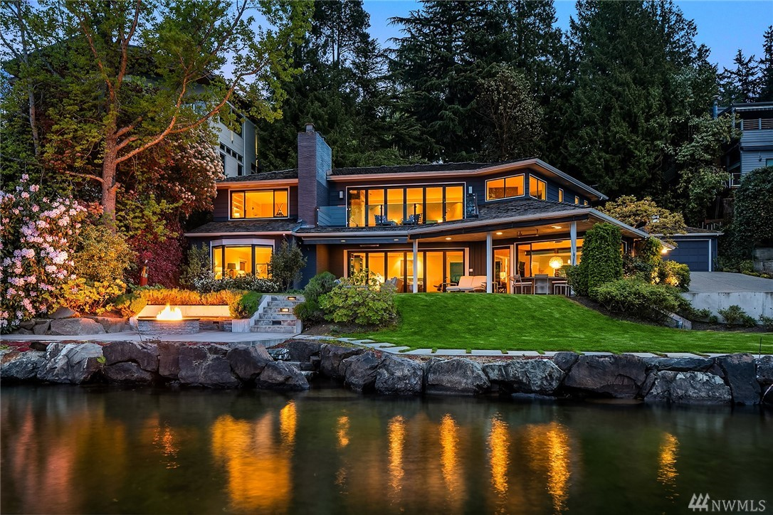 Just in time for Summer!  107' of stunning westside waterfront with unparalleled views of the mountains, lake and skyline. MI's most desired address! Original 1948 home has been thoughtfully updated & expanded. Crisp interiors married with warm woods & walls that open.  Dreamy master suite offers a front row seat to the changing views.  Second master on the main offers versatility.  Extra private parking area makes entertaining a breeze.  Deep moorage with 30' covered slip.