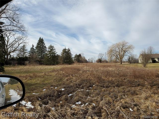 18.83 acre parcel, recently combing 2 parcels. Great development opportunity on paved Burkhart with all utilities also along Burkhart. Just 1 mile from Grand River, 2 miles from I96. Zoned Single Family. 38 water and sewer REUs allocated to the property and buyer to assume the assessment. Assessment totals $145,865 which is paid in annual installments through 2026.