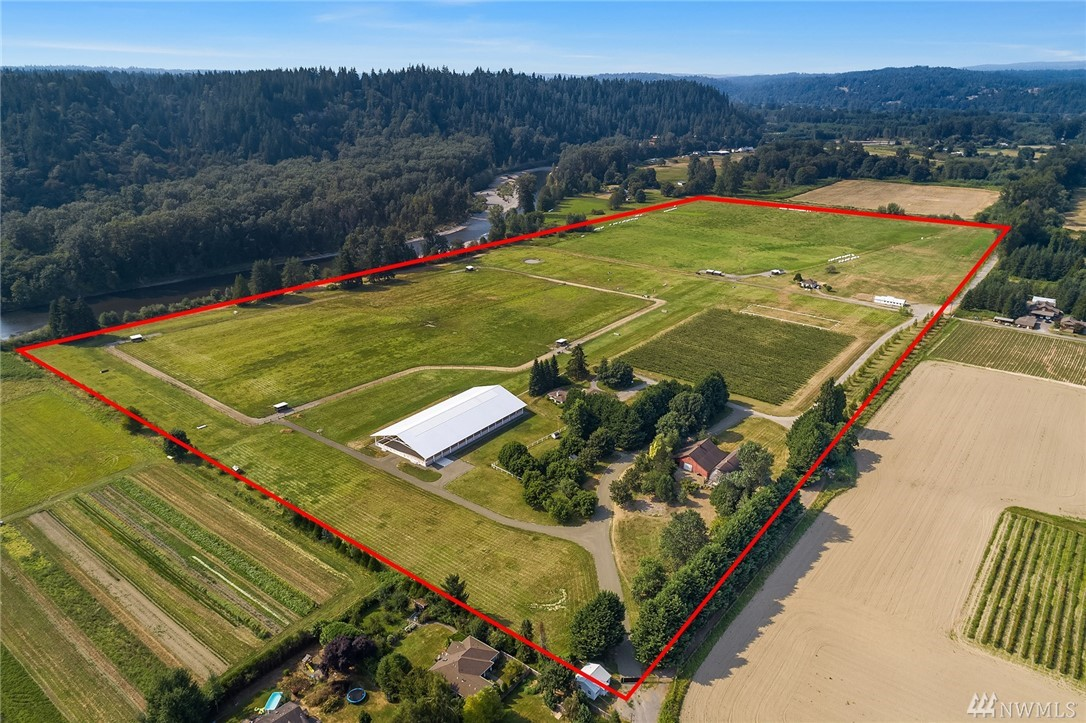 Carnation Landmark property! Explore nearly 80 acres of riverfront Country living! Mountain vistas & tremendous open pastures that go on forever. Brilliantly constructed with no expense spared 100 x 208 covered arena by Schultz miller! 4 homes on the property, one home completely remodeled, 7 tax parcels, new barn plans/renovations were permitted but not executed. Loafing sheds, Hoof-grid and numerous paddocks. Stunning one of a kind Riverfront setting nr downtown, Water Rights!