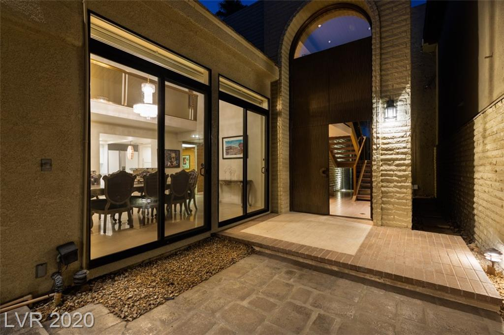 "One of a kind, In both style and history! This original Frank ""Lefty"" Rosenthal residence is now available at the Las Vegas Country Club.  Portrayed by Robert DeNiro in the movie Casino, Lefty is a legend in Las Vegas History. Running 4 casinos including the Stardust, this is the residence he called home. With Mob ties and as an FBI Informant, this home is truly amazing.  Courtyard entry home and built to commercial standards : steel framing, soundproof insulation, bulletproof windows & doors, original smoked mirrors (believed to be from the Stardust).  Rolladen shutters off primary bedroom.  Original owners suite bath, wallpaper, and other features. Floating staircase, gold leaf ceiling in the dining room, sunken living room and bar.  Many original items stay with the home.  Pool and above ground spa, this home is designed for entertaining."