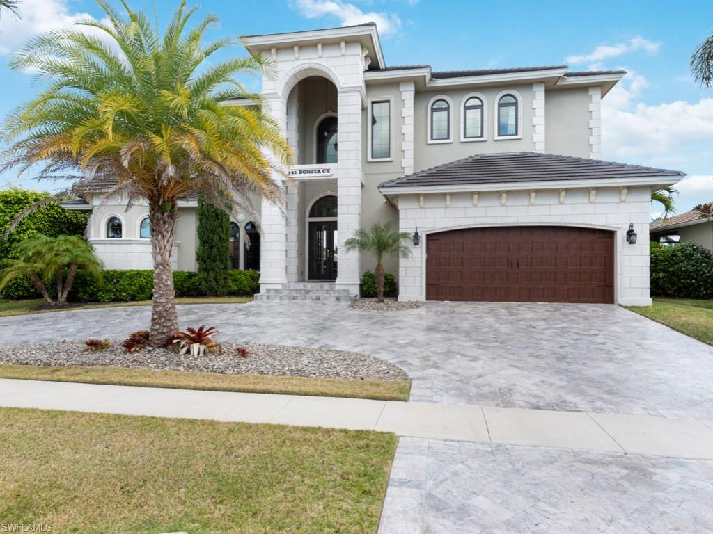 Here's a beautiful custom home built with high quality and high tasteful West Indies style. Walk to a home with a high ceilings, amazing travertine floors, and beautiful real wood cabinetry and doors. This is a spacious home with 5 full suites (5.5 baths) plus DEN, huge lanai, large pool with a spa and not to mention detailed travertine driveway and lanai floors. When it comes to fun and entertainmentplenty of space in the lanai, upstairs LOFT and spaciouslounging area at the dock. Outdoor features also includean outdoor kitchen and a dock with lifts for a boat and 2 jet skies built in 2017. Seawall was replaced in 2004. This house is one of a kind!!! It has a great income history with seasonal rentals. This is also a great opportunity for you to have a piece of paradise for your vacation and also great rental income.