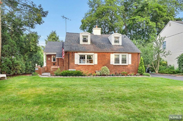 Convenient Location! Nestled on a quiet circular tree-lined street steps away from all schools, Graydon Pool & NYC Bus/Train, this 1,862 sf colonial cape has a welcoming entry foyer that leads to a sun-filled LR w/ custom built-ins & crown moldings.  Pretty arched opening to adjacent Dining Rm w/ picture window overlooking private rear yard.  Kitchen offers solid wood cabinetry, new DW & updated appliances. Cozy sunroom is perfect for relaxing w/ a book & gives access to attached garage.  Two comfortably sized BR's and Main bath w spa tub complete this level.  2nd floor boasts spacious MBR with WIC, private balcony & full bath.  Bonus room could easily be utilized as 4th BR (currently used as home office). The basement has fabulous rec room w/ custom bar, laundry room with   bath & workshop.  Features: 200-amp electric w switch for generator hook-up, mini-split air cond. units (w heat option), indirect HW from boiler great for spa tub & long showers.