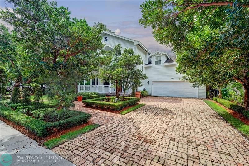 Graceful Cape Cod styling on over-sized lot (75x125) on sought after SE 8th Street in desirable Rio Vista. Two story home with wide covered porches front & rear lends to the charm of this property. Oak hardwood floors throughout, 10' ceilings, office/library with bay window & downstairs guest bedroom with full bathroom/cabana bath. Upstairs, 3 more bedrooms with huge master suite. Large pool & backyard w/southern exposure. Over the garage is a very special great room with full bathroom, vaulted ceilings, built-ins & great closets - perfect for children's playroom, music room, art studio or even additional bedroom, accessed from main house, but also with private outside entrance. Open & spacious with charming architectural features & a brand new roof, this is a very warm & inviting home.