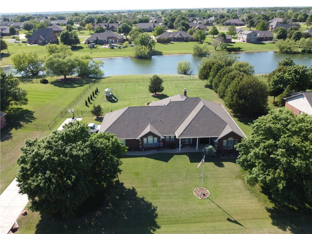 FEEL LIKE YOU'RE ON VACATION EVERYDAY! Sitting on one of the best lots in Southerly Farms!  This home has been well cared for and has everything from the outside views to the inside open floor-plan.  Large living area giving you views to the water front and beautiful backyard living, large kitchen and breakfast area along with a large dining room, 3 Bedrooms &  Study with 2 large bathrooms, great closet space and a few other extra hidden amenities! 3 car garage w/a 10 person storm shelter, RV hook up in garage, wired surround sound in living room, smart paneled wired speakers in 3 bedrooms and the office.  This community has 4 stocked ponds (catch and release) and backs up to pond 2 (just beautiful).  Enjoy sitting out on the large back porch with peaceful views including a Koi pond with fish.   This is such a tranquil and beautiful place to call home and escape from all the troubles of the day.