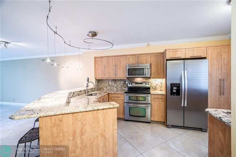 A fantastic opportunity to own a 1,210 SF LA, 2 Bed/2 Bath, updated, 2nd floor corner unit w/ an abundance of natural light. The spacious screened patio offers calming views of the beautifully lanscaped grounds, walkways & pool area of LeClub @ Cypress Bend. With only 18 corner units in the building, this unit has more windows than most, is adjacent to the secure stairwell for ease of entry & the deeded parking spot is conveniently loacted in front of the stairwell. A new side by side refridgerator was installed on 04.18.20 & the disposal & diswasher are approx. 1.5 yrs old. The unit has a stackable W/D & hurricane impact windows provide added secutity. A Rouladen shutter protects the non-impact sliding glass doors to the patio. A mix of Plantation shutters & wood blinds offer privacy.
