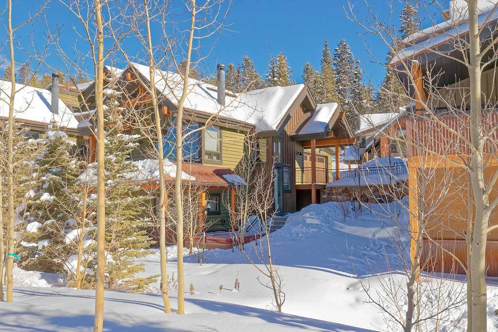 Mountain/modern construction with amazing ski area & 10 Mile Range views. Sunny open floor plan just steps to the gondola & downtown Breck. Designer furnishings & finishes includes chefs kitchen, Viking appliances, solid granite, knotty alder cabinetry, in-floor heat, luxurious master suite, 2 bdr + den comfortably sleeps 8, spacious deck & patio, private hot tub, large 2 car heated garage, never rented, built in speakers, vaulted ceilings, solid walnut floors. Never worry about parking again!