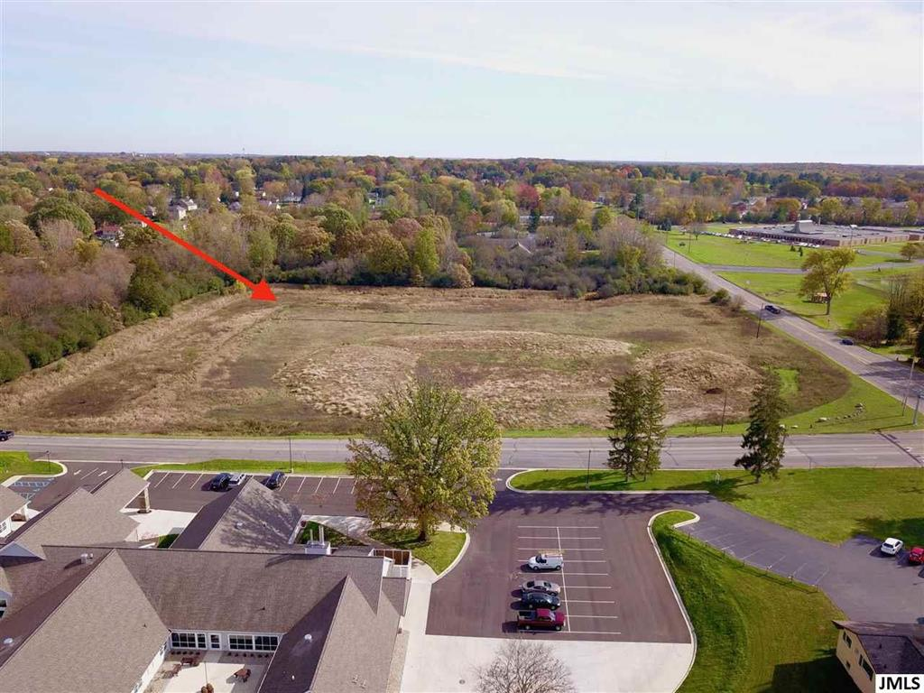 9.84+/- Prime Commercial Acres In the Path of Development. This dynamic opportunity offers a corner location on one of the highest traffic counts in the area & is less than a mile from highway access. With a combined road frontage of 1230 feet on Spring Arbor & Robinson Road, this location will give your business the high profile exposure you need. Looking for all 9.84+/- acres or part, we can build to suit or you can bring your own builder. This cleared lot is ready to go! Suitable for ample parking spaces. Be a part of the expansion of surrounding businesses!