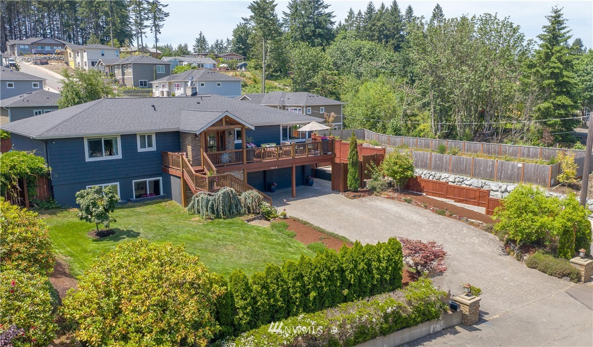 Quintessential legacy home in the HEART of the HARBOR!  Rich w/ history, style, class, & charm...this incredible 5 bed/ 3700+ sf abode IS Gig Harbor!  It lives for gatherings large & small as guests marvel at details!  Mahogany hardwoods, Johnsons' Millwork custom doors & trim, Clé tile from Sausalito in the bath, 400 bottle wine cellar/tasting room, High def theater, 3 decks, 2 patios, fountain, pond, fully fenced, amazing lighting in & out PLUS Zoned R2 for potential Home Biz, Air Bnb,  or MIL