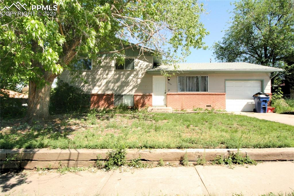 Great investment opportunity in 4 bedroom home close to everything! Newer carpet and paint throughout, kitchen features laminate wood flooring and walks out to large fenced backyard! Three sizeable bedrooms on upper level with shared bath. Large family room on lower level with additional bedroom! Laundry space includes rough in, potential for additional bathroom! Located close to schools, parks, shopping, dining and more!