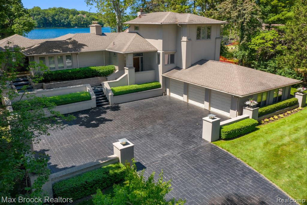 Seller has accepted an offer with a 72 hr contingency, so this home can still be shown and new offers can be presented. Fabulous 2007 TOTAL REBUILD from studs-in designed by Architect, Kevin Hart & New Custom Kitchen by John Morgan. Enjoy stunning SUNRISE AND SUNSET VIEWS from almost every room in this prime lake location w/ 115' frontage on pristine Lower Long Lake (no chemicals used) w/ access to Forest and all-sports Upper Long Lake! MOVE-IN-READY & the DOCK IS IN! Prairie School Style, exceptionally executed w/ ORIGINAL FRANK LLOYD WRIGHT STAINED GLASS ENTRY, all new Pella windows w/ inner retractable blinds, Anderson doors, all bathrooms updated, and 4 fireplaces! 3 bedrooms on entry level. New addition has a huge upper level master suite, balcony, his and her baths w/ heated floors and walk-in closets, office area and an additional laundry room. Finished lower level (B-dry system, 2 sumps) w/ family room, office/5th bedroom, full bath, large exercise room and sauna. BH schools