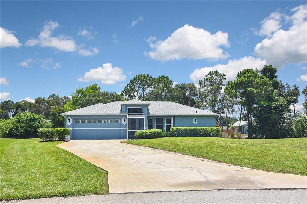 Looking for space? Paradise found!  This spectacular pool home offers three bedrooms, 2 bathrooms, a large two-car garage, and a huge 1/2 acre lot with a canal in the rear of the property.  RV and boats welcome! NO HOA rules or fees. This home is immaculate, and pride of ownership radiates throughout.  A new roof was installed in 2020, the water system is less than two years old, and the owner's suite has a new/ upgraded shower.  With an open great room and volume ceilings, this home shows very light and bright. Located in a PRIME SW Florida location close to FGCU, I-75, schools, shopping, dining, and of course world-renowned beaches minutes away.