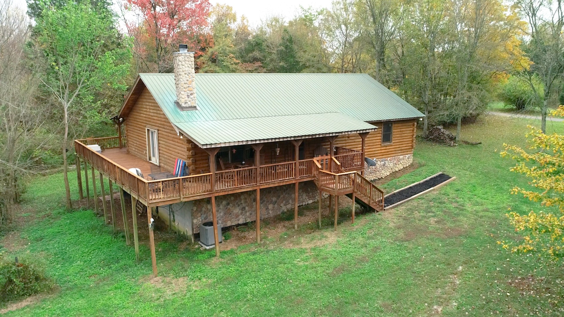 Private Oasis on 5+ acres w/just minutes to I-65 & I-840. Custom built log home. Enjoy beautiful sunsets from your wrap around rocking chair covered deck. Lots of room for your RV & boat parking. Home includes wood burning stone fireplace with vaulted ceiling, spacious rooms.  Main floor has primary bedroom suite, 2 spacious bedrooms, 2 baths, & a large country kitchen. Basement level has large bedroom with bath, large den with electric fireplace, garage & storage. Located in Williamson County.