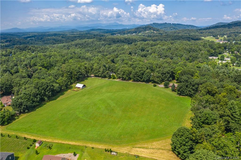 Beautiful pasture in the Cane Creek area of Fletcher/Fairview. This gently sloping land has gorgeous mountain views. Property is fully fenced with barbed wire fencing and pasture also includes a barn. This land would be great for a private residence, mini farm, or even some development. Natural gas available down the street. Well and septic would be needed as well. Come take a look at all this property has to offer. By appointment only. No drive-bys.