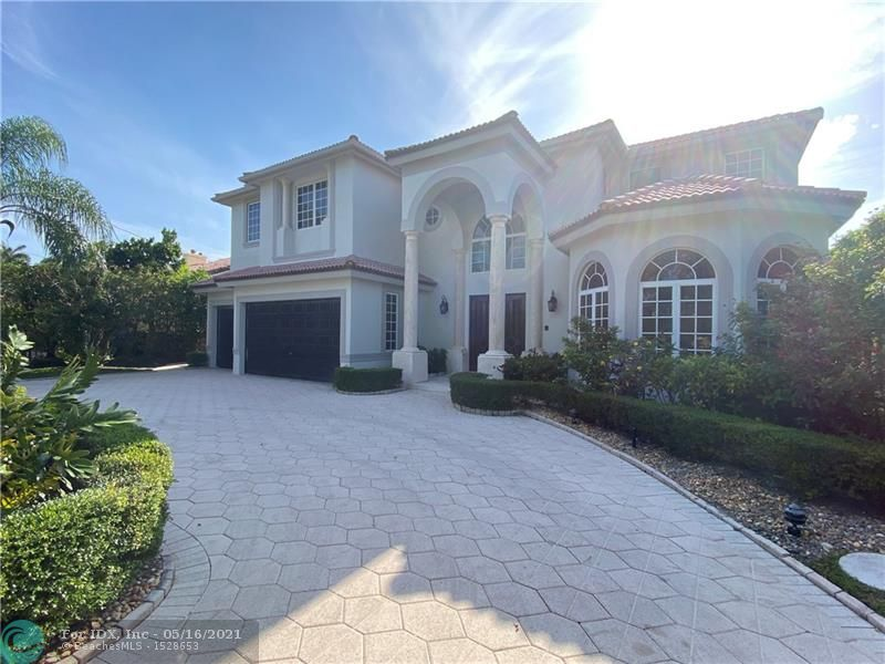 This home in prestigious & security patrolled seven isles neighborhood has 5 large bedrooms plus spacious office, 6 bathrooms, elevator, 3 car garage, and 5870 total square feet. The scale and design of this home make it truly unique. Every bedroom includes en-suite bath and walk-in closet. Prime lot is 2 homes from the point with 25 foot foot high ficus hedges providing added privacy. Additional features include large circular driveway with landscape island, big covered patio in the backyard, rare 20x40 pool, downstairs VIP suite, and a large balcony off of the master bedroom providing views of Rio Barcelona waterway. With an amazing location & great floor plan, this home is ready for your personal touches.