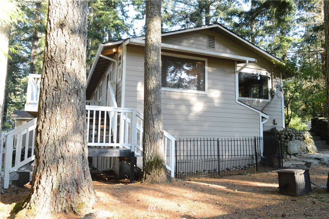 This beautiful 4 bed/2.25 bath home sits among mature pine trees and is located within walking distance to two Lake Wm. Symington parks. Close proximity to Wildcat Lake, Seabeck Marina, Scenic Beach, Green Mountain trails, and Guillemot Cove Nature Reserve. Fully fenced yard front and back with two decks and upper and lower entrances. Shed and shop on property. Durable waterproof laminate, granite counter-tops. Large daylight basement features family room, laundry room, and office. Seabeck area.