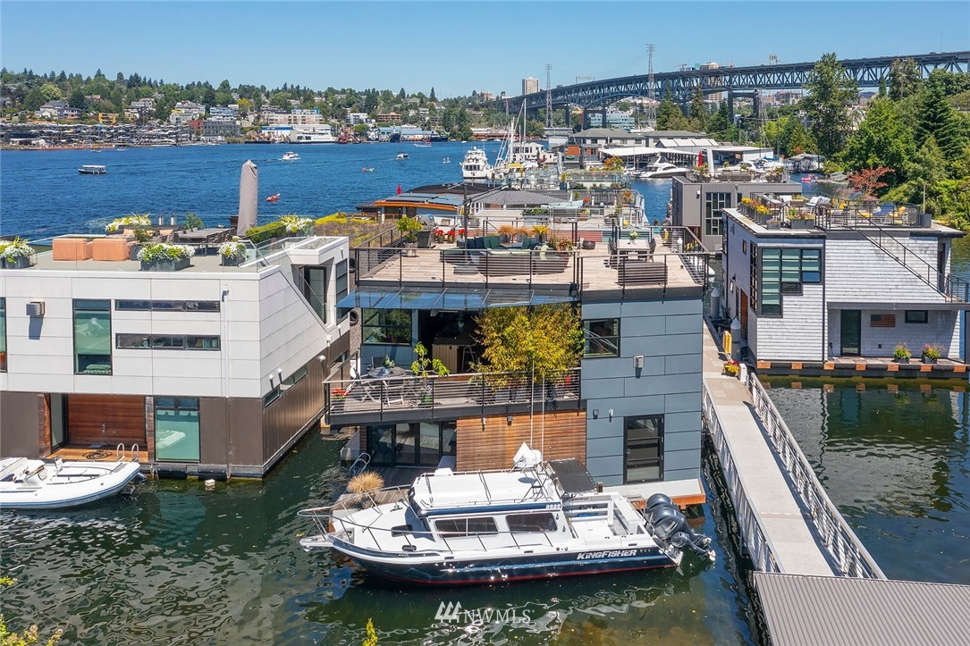 A rare opportunity to live at Seattle's premier floating home community of Wards Cove on Lake Union. Meticulously maintained, this quality built floating home from Dyna Construction surpasses all expectations. Top floor features voluminous open floor plan w/chef's kitchen with custom cabinetry, eating bar, tv room off the kitchen, sliding doors open onto a covered heated patio. Main level features 3 beds, primary has walk in closet, en-suite bath w/radiant heat and a luxurious steam shower. Sliding doors open onto water level deck with outdoor shower and moorage of up to 32' boat. Enormous rooftop deck with views of the lake, downtown, glorious sunsets and all the boating activity the lake offers. One gated off-street parking space.