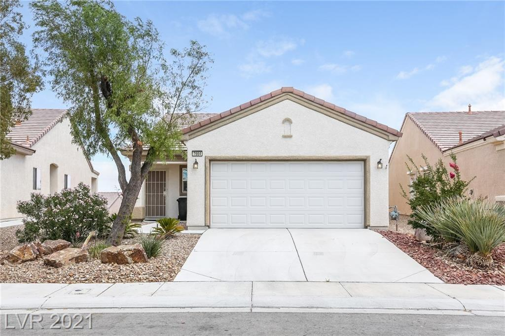 This North Las Vegas one-story home offers a patio, granite countertops, and a two-car garage. This home has been virtually staged to illustrate its potential.