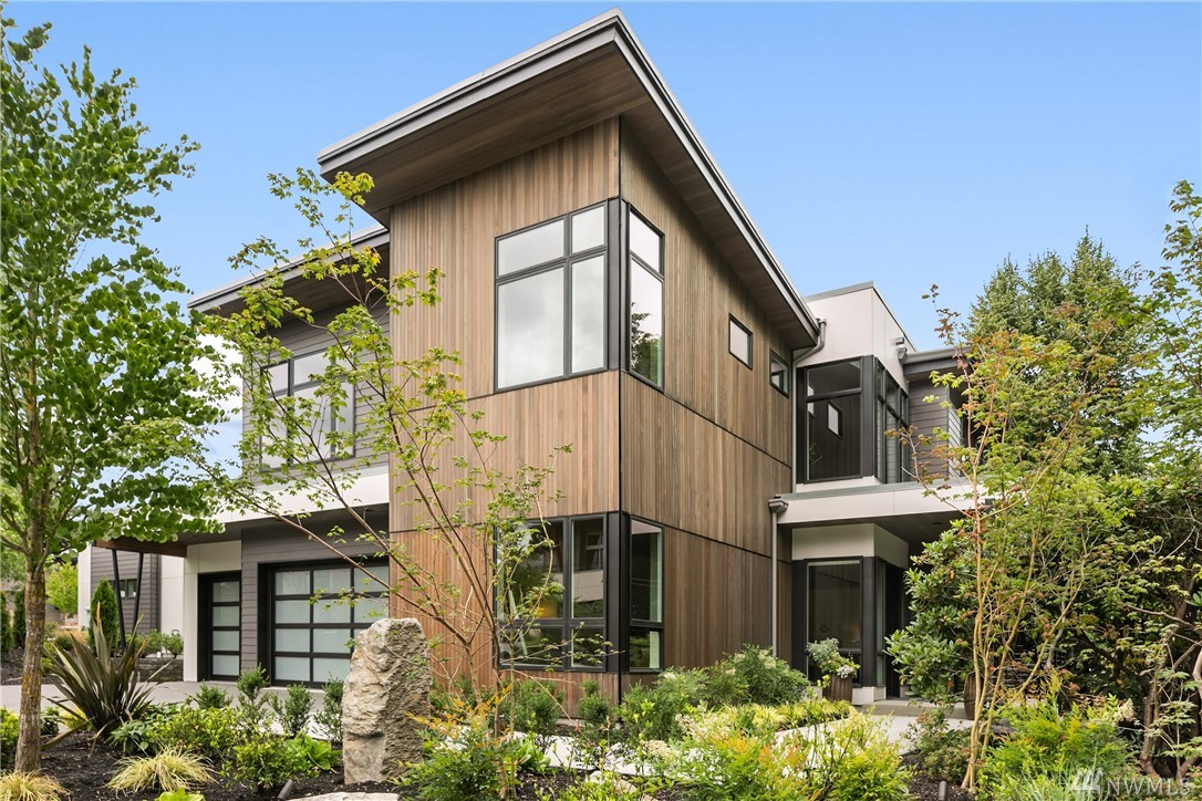Welcome to Summerwell, Mercer Island's first new neighborhood in almost 30 years! Homesite 1 is a casual entertainer's dream! Open concept w/seamless flow from the 2-story entry to the dining room which adjoins the voluminous great room, kitchen, sun room & informal nook. 611 SF of outdoor living area w/built-in fireplace. Upper level loft overlooking the great room + Master & 2 additional bedrooms up. Gourmet kitchen, Miele appliances, Poggenpohl cabinetry. Lovely fully fenced flat back yard!