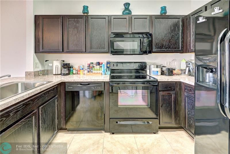 FHA OK!!! Nice *NEW construction* (Less than two years old!!). Gorgeous 2-Story Townhouse with 2 bedrooms & 2.5 bathrooms. Both Bedrooms are Master Bedrooms with their own bathrooms & closets! Large front garden court yard area & covered patio. Gorgeous community! Open concept floor plan with tile on the first floor. Washer & Dryer are inside of the townhouse! Centrally located 15 minutes away from the beach, shopping malls & restaurants (Lakes Mall, Walmart, Coral Ridge Mall), entertainment (Funky Buddha Brewery, AMC theater).  Close to highways (Turnpike & I-95), Airport (Fort Lauderdale 15 minutes) & more! Built in 2017. Great place to live! FHA and VA approved. Ok to Lease. Pets are welcome! Large pool, playground, clubhouse, maintenance includes high speed internet & basic cable.