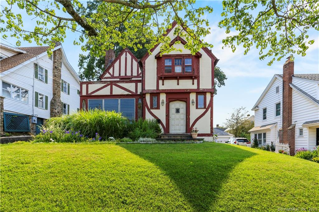 """LOCATION, LOCATION, LOCATION for this diamond in the rough. Across the street from the Long Island Sound and part of the coveted ALC Beach in Shippan, this home has so much potential. Wake up every morning to fabulous views, and steps from the beach, this home is waiting for buyers to make it their own. The oversized living room boasts hard wood floors, a fireplace, beamed ceilings and 2 sets of french doors-one leading out to a screened in porch and the other to a private patio and backyard for all of your outdoor entertaining needs. Curved doorways lead to large dining room and eat-in-kitchen. Beautifully carved wood staircase leads you to the second floor that offers 4 bedrooms. Full bath on the second floor and first floor powder room have been renovated. Large unfinished basement. This home needs exterior wood repair, as well as some interior repair. This is the PERFECT home for a buyer with a vision. And someone that wants to live in a fabulous beach community. Bring your imagination, your ideas and restore this beauty. House being sold """"as-is""""."""