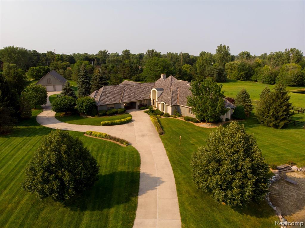 Luxury Ranch On 10 Acres! Over 4000 Sqft Of Space On The Main Floor Alone! Fully Finished Walk Out Basement With Over 3500 Sqft Of Finished Entertaining Space.  Priced At $108 PPF. The Home Offers A View Of The Fenced In Horse Pasture Or One Of Three Private Ponds From Every Room In The House. Featuring 5 Bedrooms And 4.5 Baths. Other Features Include: Master Bedroom With Shower & Soaking Tub In Bathroom, Private Fire Place & Walk-Out Door To The Cedar Deck, All Bedrooms Have Walk-In Closets,  A Bonus Heated/Cooled Office Space Over The Garage, 15 Foot Cherry Bar In Basement, Granite Kitchen Counter Tops, 6-14 Inch Oak Trim Molding Throughout, Irreplaceable Stone Throughout The Home Shipped In From Italy, 3 Car Attached Heated Garage, 2 Car Detached Heated Garage All Connected By Breezeway! Horse Barn With 4 Horse Stables! Offers A Country Feel But Close To Town, Hospitals, Shopping And Freeways! Only 20 Minutes From Frankenmuth! Please Inquire For A Copy Of Our Feature List.