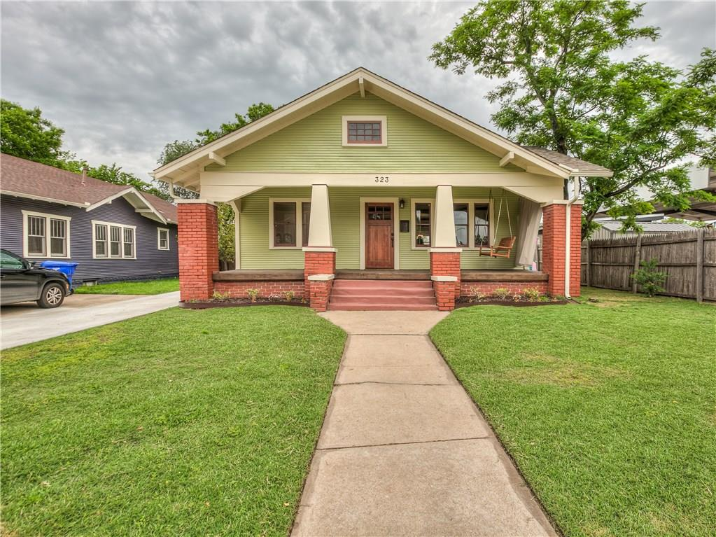 THIS IS A COMPLETE AND BEAUTIFUL RESTORATION OF A CRAFTSMAN BUNGALOW BUILT IN 1922. SITUATED IN THE MILLER HISTORIC DISTRICT, SHORT WALK TO CAMPUS AND MAIN ST. ARTS DISTRICT.  FRONT PORCH COMPLETE WITH NEW OAK SWING. ALL NEW HEAT AND AIR, HOT WATER TANK, ALL REFINISHED OAK FLOORS, ORIGINAL OAK WOODWORK. ORIGINAL BRICK GAS FIREPLACE WITH OAK AND GLASS DOOR BOOKCASES.  ALL FINISHES ARE PERIOD AND LOVELY. KITCHEN WITH  OAK CABINETS, FARM SINK, QUARTZ COUNTER TOPS AND SUNNY BREAKFAST ROOM. LOVELY  BATH WITH CLAW FOOTED TUB / SHOWER AND LARGE PEDESTAL SINK.    LAUNDRY ROOM OFF KITCHEN WITH NEW SINK AND FOLD DOWN IRONING BOARD. LARGE BACK DECK OFF LAUNDRY.  ALL NEW OVERSIZED ONE CAR GARAGE.