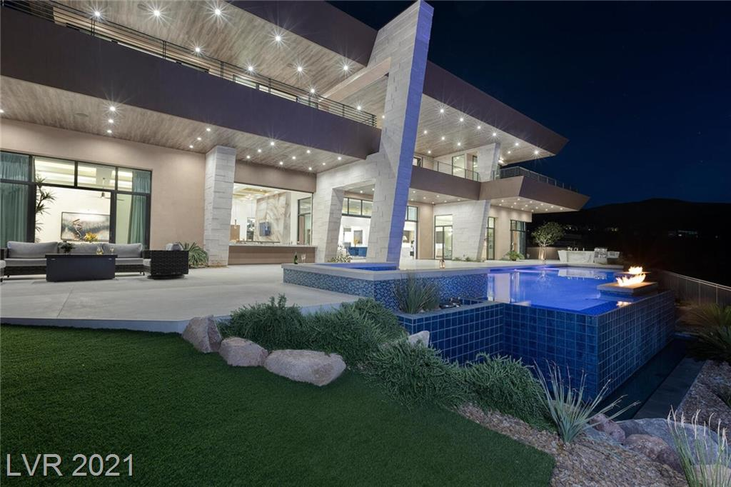 Smart, Sleek & Sexy. Mesmerizing Modern Custom Estate with Sweeping Strip, Mountain & City Views by Richard Luke, AIA. 10,030 SF | 5 Bed | 7 Bath | 4 Car | .53 Acres. Open Indoor-Outdoor Concept with Dramatic Architectural Lines and Gorgeous Finishes. 10 Seat Movie Theatre, Billiard Room w/Strip Views, Game Room w/Strip Views, Wine & Whisky Bar w/Strip Views, Glass Wine Cellar, Office. Wolf /Subzero Kitchen w/Strip Views, Dining Room w/Strip Views. Strip View Master with Spa Bath and Luxurious Walk-in Closets, Linear Fireplaces, Auto Glass Pocket Doors, Auto Shades, Control 4 Smart Home Technology, Surround Sound, Elevator. Outdoor Kitchen & Bar, Infinity Pool and Spa with Fire Features. Click Tour to see Movie