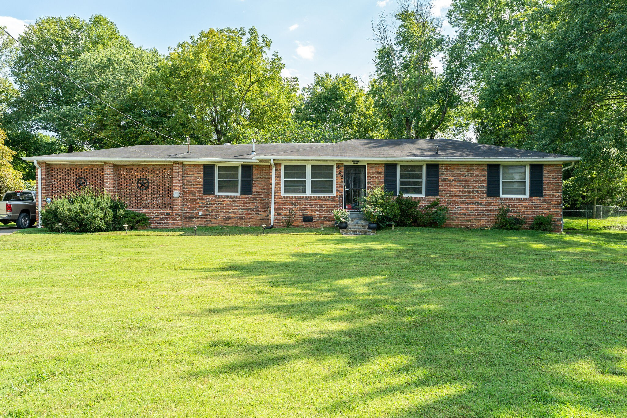 Lovely home on 1.23 level acres. Excellent location B/T I-24 and I-65 Large workshop with a car port and electric. Large fenced back-yard with a 2nd fenced area for pets. This could also be and investor/developers dream.  Showings begin Friday 9/17/21 Open House 9/18 and 9/19 2-4 pm