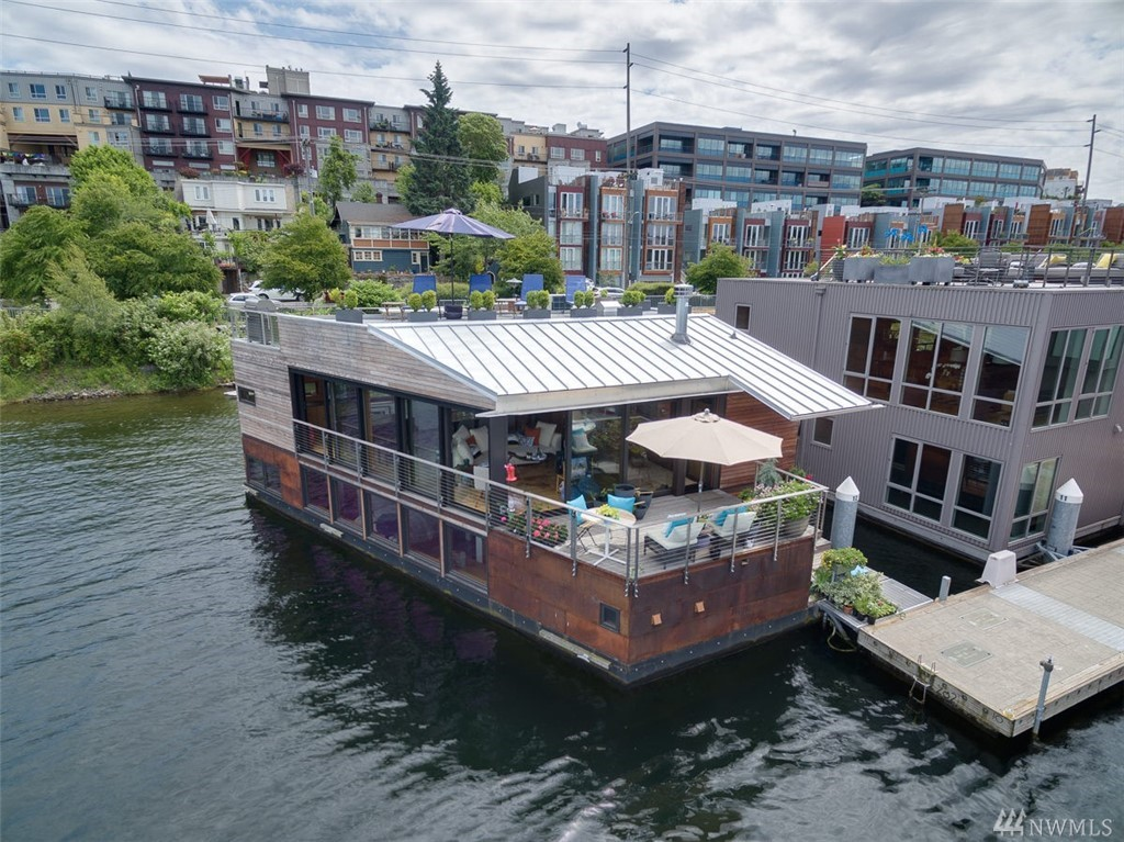 A breathtaking floating home for living in-the-moment, designed with the precision of a Swiss watch. A stunning Living and Dining Room and Gourmet Kitchen with a 270-degree view over Lake Union provides the perfect setting for contemplating, entertaining, celebrating.  A Master Suite at waterline, with 5-piece luxury bath that includes a wood Japanese Soaking Tub.  2 additional bedrooms with a jack-and-jill bath.  Private gated entry, parking & storage. Boat Moorage.  Welcome Home!