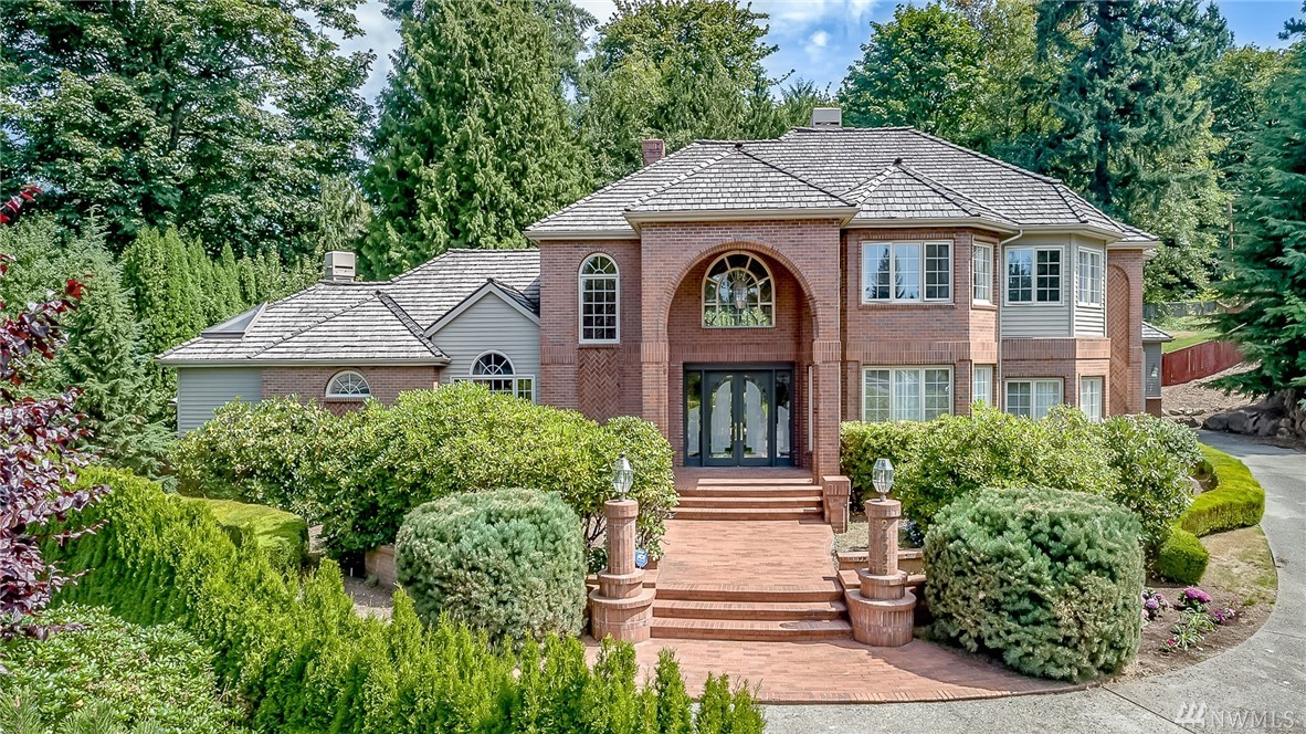 Luxury and elegance in every detail! Located in a cul-de-sac in the Lake Washington School District, this extravagant home offers a stunning master suite, an office, a formal living, a dining room, three fireplaces, a newly remodeled kitchen, and a wine closet. On entry, find a grand staircase and glass chandelier. The open floor plan includes marble flooring and high ceilings! The large, lavish backyard has a gorgeous deck and is fully fenced. A rare find!