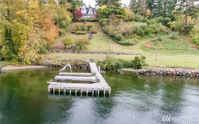 A rare Medina waterfront opportunity. The retreat on Evergreen Point Road,distinguished 1.46 acre estate in the heart of Medina.Impeccably manicured, gated grounds.89 feet of western waterfront on Lake Washington; a library at the prow of the home.9,010 square feet of elegant livability.Day rooms;music salon;guest quarters.Recreational compound: indoor pool, wine cellar, billiard, boating swimming.Spilling over with Olympic mountain, Seattle city and lake views. Including two parcels.