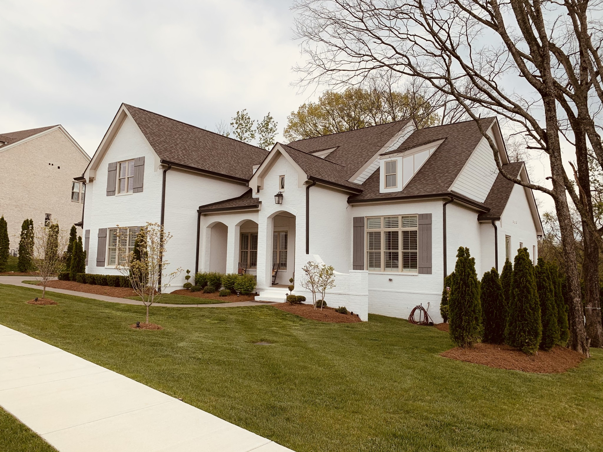 Immaculate custom home built in 2019. This Luxury 5BR/5.5BA home is MOVE IN READY. New Construction w/o the wait! Home is FULLY FURNISHED. 3 beds + office on main. 2 beds + bonus up. Full-yard landscaping, sod & irrigation, landscape lighting, fenced backyard, screened back porch w/ fireplace, plantation shutters, custom fixtures throughout, hardwood floors added throughout, exterior brick painted, and beautifully decorated.