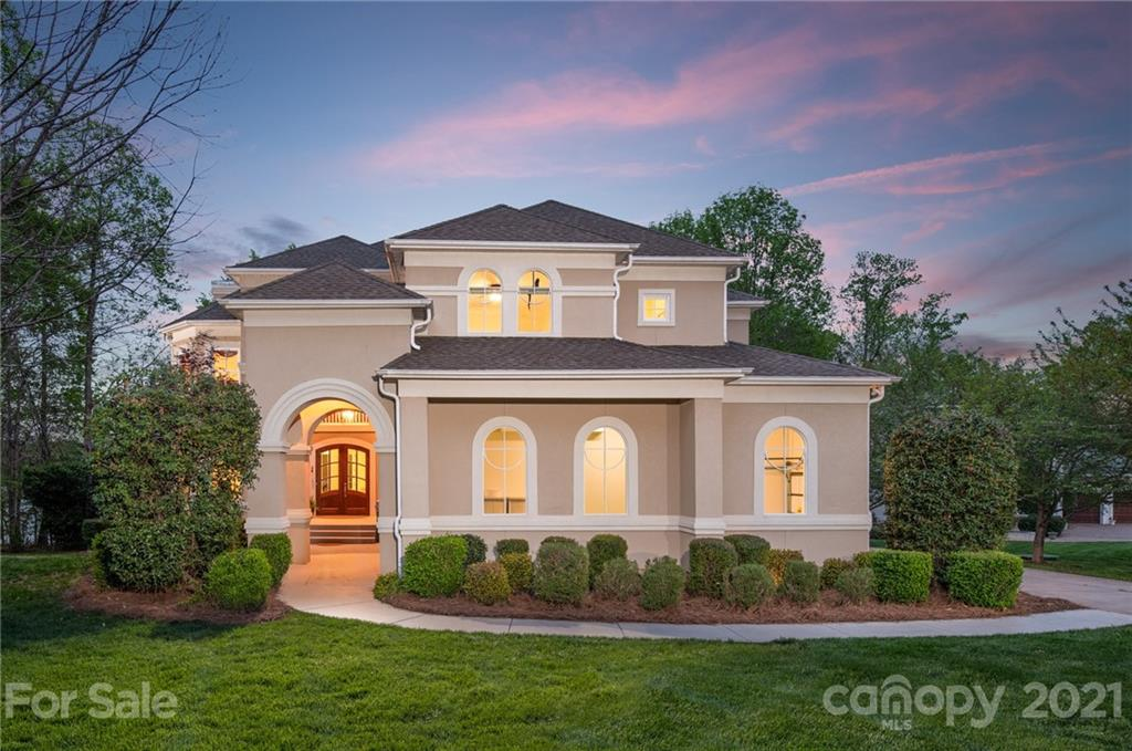 Exquisite modern meets Lake Wylie in Woodland Bay, a premier gated waterfront community in Belmont NC. Approach the front door to see sweeping lake views. Step inside to lake views from your main living spaces. This waterfront homesite is fairly level so it is easy to navigate to your outdoor living spaces and boat slip. Woodland Bay is a small community of stunning custom homes located minutes to the airport and about 30 minutes to uptown Charlotte. Daily essentials and grocers are within 10 minutes, yet this location allows you to relax and feel the space around you. When inside, neutral colors and expansive views brings the lake inside. While in the kitchen you are watching the lake. Relax in the evening or play on the weekend in your saltwater pool and sauna. Plenty of space with a finished basement. Multiple fireplaces warm you when the wind has a chill. Cruise the lake on your craft of choice from your boat slip, or enjoy the waters edge from a fire pit. So much to love here!