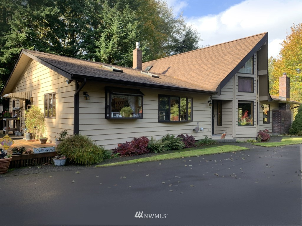 Exceptional, private custom home near highly regarded Adna.  Paved driveway bends thru trees to the beautiful setting & large paved area beside the house.  Boasting a wood stove, propane stove, propane heaters and an electric forced air furnace, you WILL be cozy!  Being wired for generator is a bonus! Listed as 2 bedrooms but could be 4.  Detached 3 bay garage has shop, canning room, bathroom & space for YOUR projects.   Outside tree thinning could bring back the mountain view.  All new skylights are coming!  The raised bed gardens will lead the way to welcome spring this year.  Inside, high quality windows set the good bones example.  This home is move in ready but waiting for your gradual touches.  Craft your ideal secluded oasis in Adna!