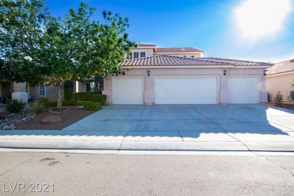 This fabulous palace has virtually everything you are looking for! Enjoy a rare four-car garage set up with ample space and upgrades galore. The kitchen features modern cabinetry with an island, custom countertops and top-of-the-line stainless steel appliances. The living room and great rooms have been combined for maximum living space. Upstairs you will find generous sized bedrooms with a large den sure to accommodate all your business and/or entertainment needs. The spacious backyard features a covered patio with plush sod and a refreshing pool and spa combination sure to wow all your friends and family. There isn't much this home doesn't offer, come and see why it is the best on the block. Make it yours today!