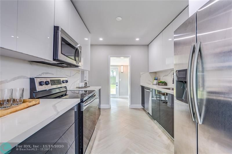 BEAUTIFULLY REMODELED MODERN 2/2 HOME IN OAKLAND PARK! BRAND NEW 2019 ROOF, NEW HURRICANE IMPACT WINDOWS, & BRAND NEW 2019 A.C. ! CUSTOM KITCHEN, BATHROOMS, FLOORING, AND RECESSED LIGHTING THROUGHOUT. KITCHEN FEATURES QUARTZ COUNTER-TOPS AND BRAND NEW S/S APPLIANCES! FRESHLY PAINTED INSIDE & OUT + NEW IRRIGATION SYSTEM AND LANDSCAPING AND SOD! HURRY, THIS HOME WILL NOT LAST.