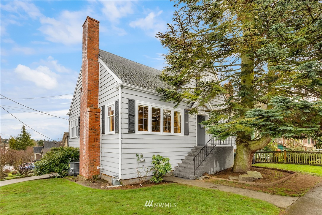 1920s-era Greenwood home offers an ideal opportunity to create uniquely-you custom updates. 4-bed, 2-bath, 1420 SF of living. Stain glass rose entryway door invites & gourmet chef's kitchen is primed for epicurean delights. Open atmosphere is both cozy & bright. Set on an ample lot, there's plenty of room for loved ones to BBQ and play outside, while the neighborhood offers an abundance of amenities including shops and restaurants, with a WalkScore® of 90. Discover the rose of the neighborhood!