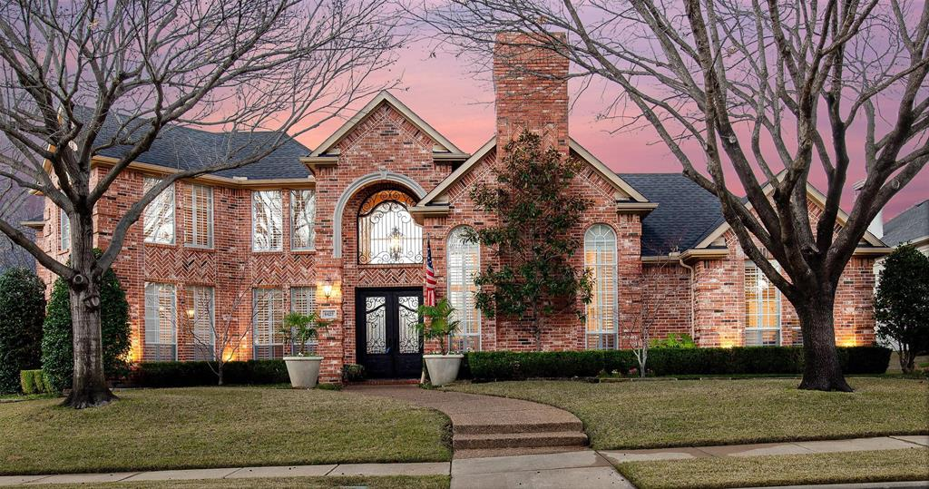 Twilight view of this amazing sprawling corner estate on 6429 Shady Oaks Lane. Situated in the prestigious Cypress Point in Plano.