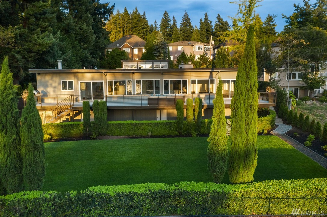 ENTERTAIN IN STYLE!  What if your favorite weekend getaway destination was home?  This brilliantly contemporary property dazzles with extraordinary finishes and glows with warmth and light at every turn.  Your luxurious kitchen looks over an amazing over-sized pool with wet bar that feels like you've been transported to your favorite resort.  Stunning Lake Sammamish views, shared moorage, 5 bedrooms, a large yard, and a deck screaming for 30 of your closest friends.