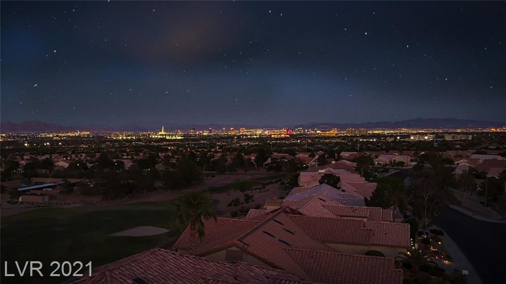Views, Views, Views!  These views, from the backyard and inside the house cannot be beat! Over the fairway and off in full view is the Fabulous Las Vegas Strip, Downtown Las Vegas  AND city lights! you can't get this view for the price. The Royale model is 2 bedroom, 2 bathroom with an open concept living space. Kitchen has breakfast bar, and eating nook. Flexible space layout nook, living room and dining or office area. Covered patio and easy care desert landscape merge to make this a one-of-a-kind property. Sun City Summerlin is Premier 55+ golf cart allowable community with 3 Golf Courses, and many amenities including 4 indoor/outdoor pools, work out facility, tennis and pickle ball courts, social clubs and activities galore! Nearby Downtown Summerlin with dining, shopping and a recently built triple A ballpark, Golden Knights practice arena and MORE!