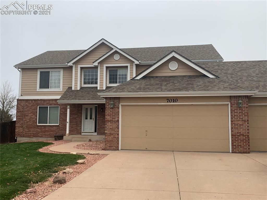 If you are looking for a large, executive family home with SPECTACULAR PIKES PEAK AND MOUNTAIN VIEWS, you have just found it!!!  This 6 bedroom, 5 bath home offers new paint, new carpet, and new granite kitchen counters.  The large eat in kitchen has a breakfast bar, center island, gas cook top, double ovens, hardwood floors & large pantry.  The large master offers an adjoining 5 pc bath & walk in closet.  There are 4 additional bedrooms on the upper level & 2 full baths.  The fully finished basement offers a custom theater room with leather seating, a large recreation room with gas fireplace, the 6 bedroom & full bath.  The .44 AC lot is fenced and fully landscaped.
