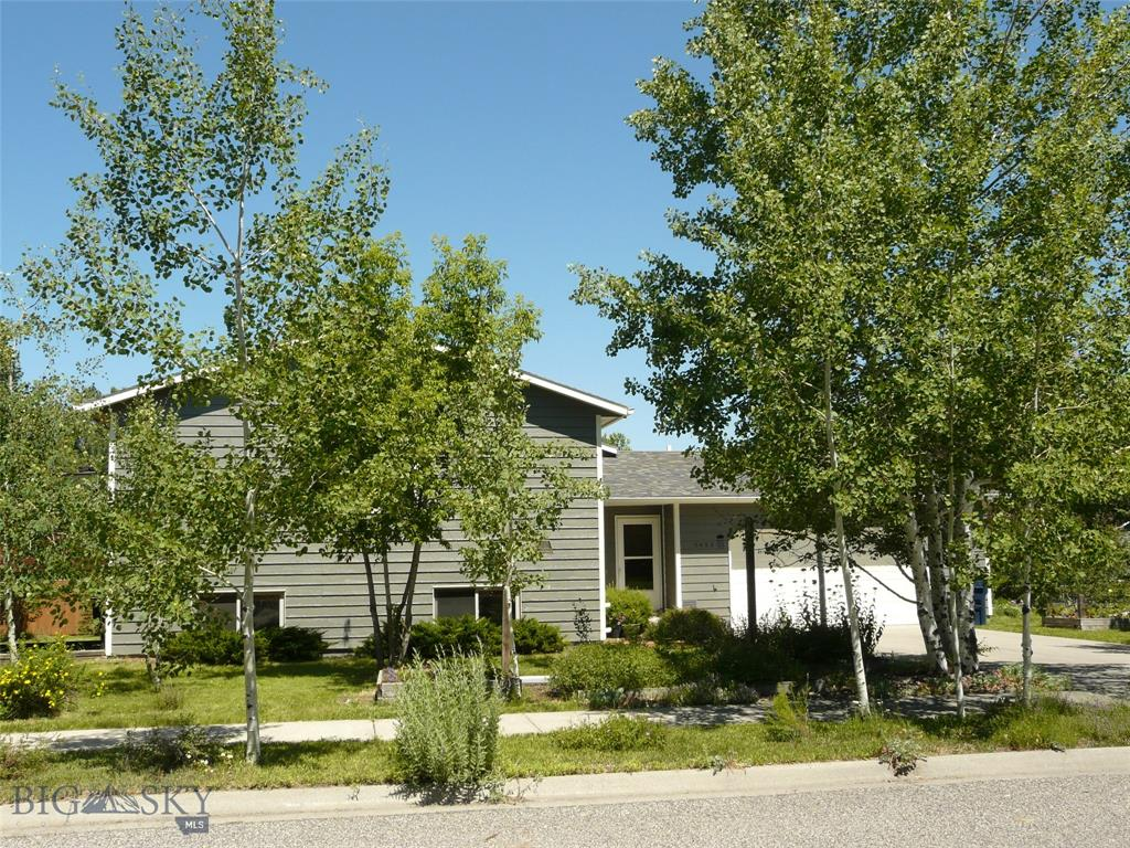 This spacious and classic designed bilevel  built by well known 90's Bozeman builder Jack Allen offers all the features you will need. Starting from the ground up, the home sets on a large 1/4 acre corner lot on a quiet street in a great subdivision 2 blocks from Hyalite Elementary School and convenient to shopping (1/2 mile from Gallatin Valley Mall ) and the Bozeman Pond Park. The lot is landscaped to attract a myriad of native birds and provide shade in the warm summer months. Street lamps make the subdivision warm and inviting at night. The home's upper level offers an open living/dining/kitchen floor plan plus master and 2nd bedroom. Large windows and deck off the dining area make for light and airy living. The lower level boasts two additional large bedrooms , a third bath, plus a spacious family room. The garage will hold two cars plus storage for all your tools,camping and fishing gear. Current owners had the exterior repainted, roof and windows replaced  within last ten years.