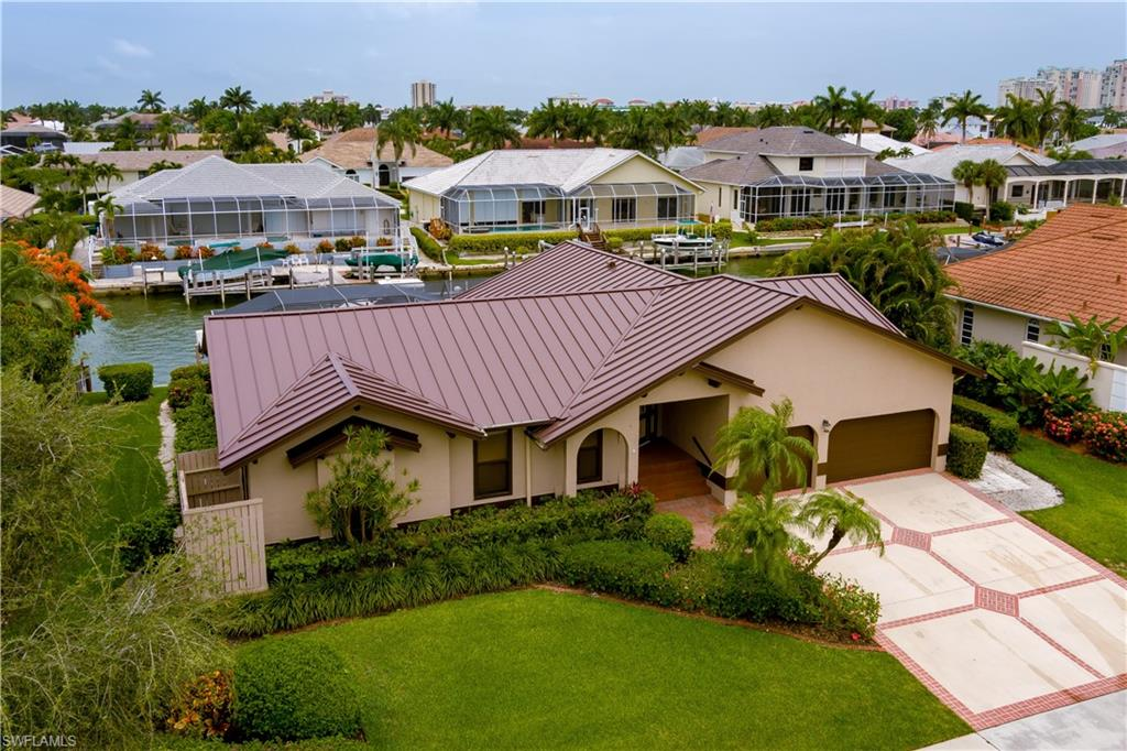 Southern Exposure. Direct Boating Access. New Roof. New Dock. New Lift. Very desirable south island location. 3 Car Garage. Minutes to the beach.