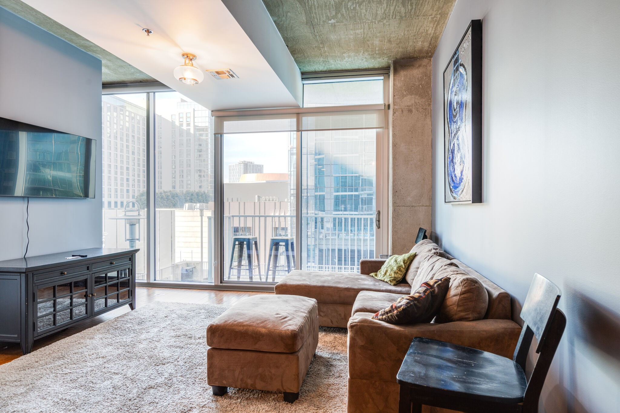 Rare Find: Luxury Condo w/ Balcony, in the Heart of Downtown Nashville, SoBro! 3 minutes to Broadway! Envy-worthy skyline & pool view! Floor to ceiling windows, new appliances, secured parking, custom closet & solar shades!  Amenities Galore: 24/7 Concierge, Rooftop Pool & Terrace, Free WiFi & Coffee, Fitness Center, Designer Firepit, Grills, Herb Garden, Shuffleboard, Pool Table, and Theatre Room. Restaurants: Bakersfield, Etch, Farmhouse, Jimmy Johns and Starbucks are located downstairs!