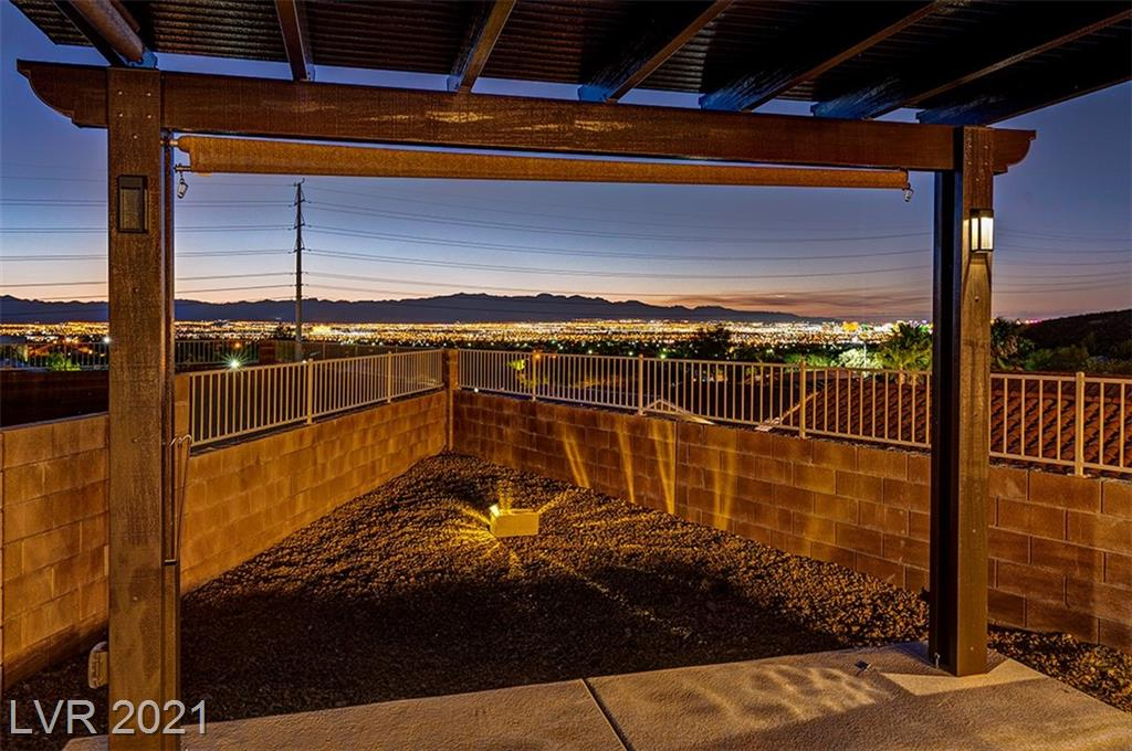**MILLION DOLLAR PANORAMIC VIEWS**Gorgeous STRIP and MOUNTAIN views on a 1/4 ACRE LOT! ELEVATED FOR SWEEPING SIGHTS!  NEW SALT WATER POOL with WATERFALL, LED LIGHTS, and FENCE! Gorgeous PERGOLA to sit and relax, OVERLOOKING THE WHOLE CITY AND STRIP! Home is in a CUL DE SAC, GATED community in SUNDRIDGE MANOR! Home is walking distance to PARKS AND BIKING TRAILS! ZONED for the SOUGHT after schools LAMPING, DEL WEBB, CORONADO, CORAL ACADAMY and HENDERSON INTERNATIONAL! This home is a FORMER MODEL, COMPLETELY UPGRADED, with stamped concrete and pavers throughout the GORGEOUS 1/4 acre YARD! Gardeners? VEGETABLE BEDS, LEMON, ORANGE, FIG, and POMEGRANATE TREES! Home has been 100% updated with new paint, flooring, cabinets, hardware, landscaping, and lighting. THIS YARD IS SO RARE IN A GATED COMMUNITY! Grass RUN for FUN...Pups, Kids or Adults! THIS IS AN ENTERTAINERS DREAM!!!! Home has NEW Solar Screens, Water Softener, Stainless Appliances all included, garage storage! HURRY BEFORE IT'S GONE!