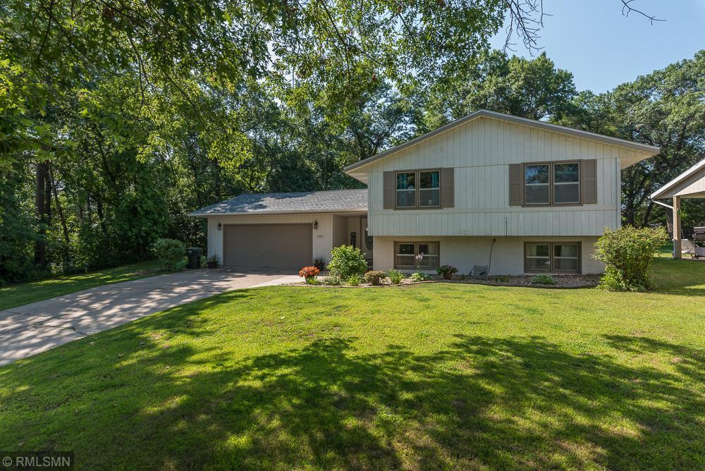 Welcome to this well-maintained home with noticeable exterior features such as new shingles installed in 2017 & concrete drive. Upon entering, enjoy the large ceramic foyer, newer carpet, a large eat-in kitchen features white cabinets, accesses the expansive deck, full basement wired for surround sound. Has as fireplace and wet bar for entertaining. The backside of the garage has a private patio. Mechanicals includes newer 95% efficient furnace and water softener.